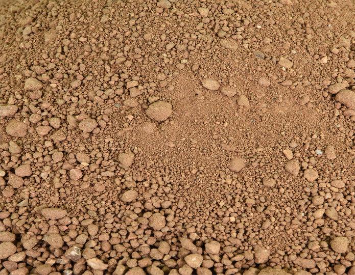 Brimstone decomposed granite fines in bulk at rock yard