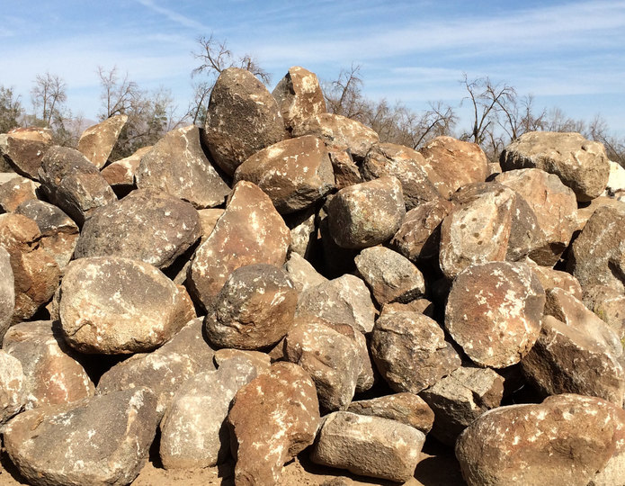 Surface Select landscape boulders in rock yard
