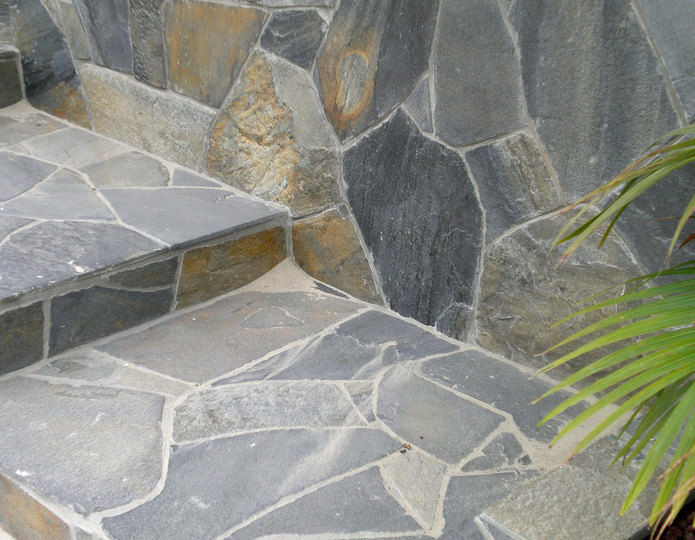 Red Mountain natural flagstone patio pavers installed on wall and stairs