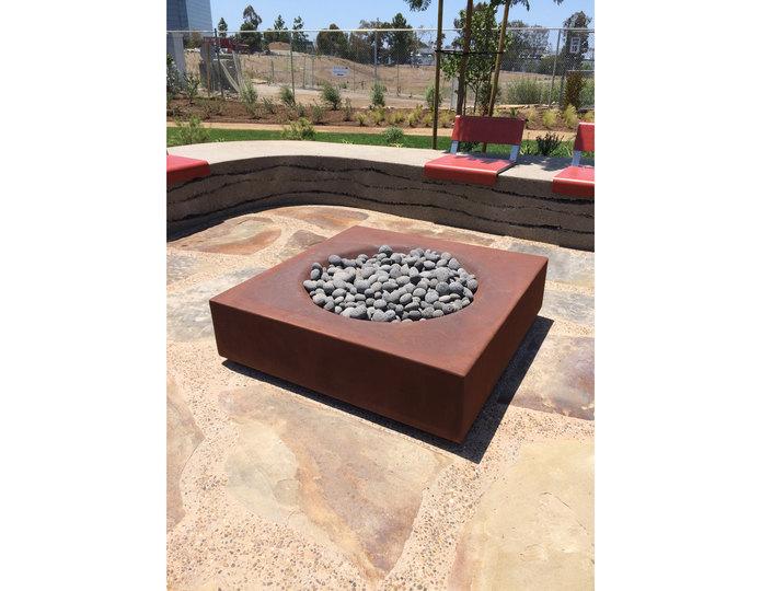Black Mauna Loa pebble in fire pit at Summit Rancho Bernardo designed by LdG Landscape Architects