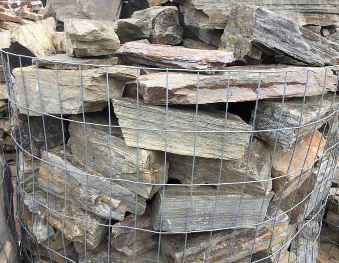 Barkwood ledgestone in gabion basket at rockyard