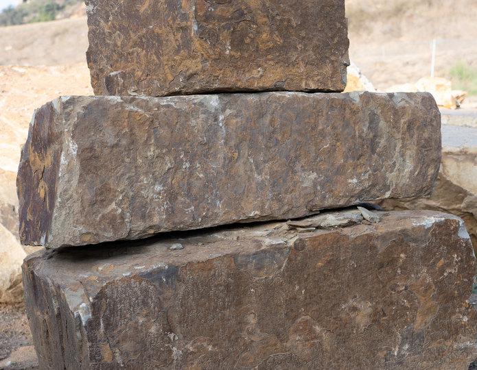 Browns ranch bench landscape boulder stacked on pallet in rock yard
