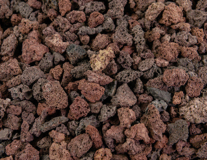 Red Lava crushed stone rock in bulk at rock yard