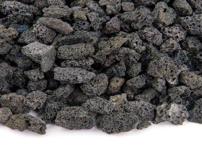 Black lava crushed stone rock closeup texture