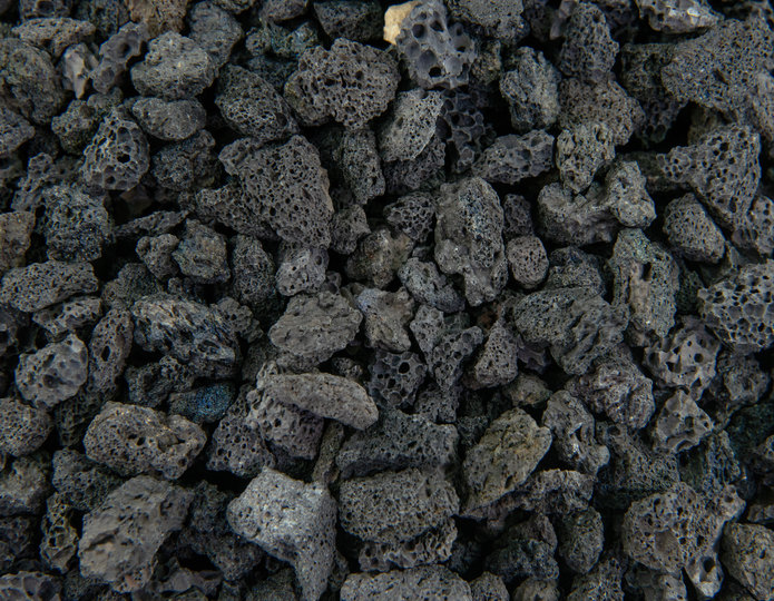 Black lava crushed stone rock in bulk at rock yard