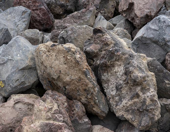 Lava landscape boulder pile in rock yard