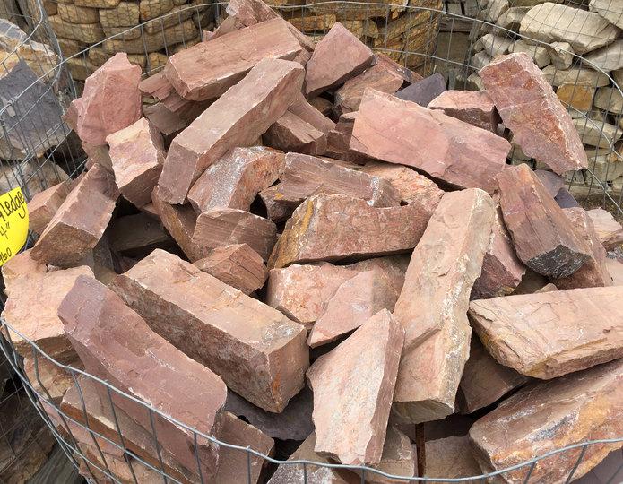 Basket of Arizona Rosa Ledgestone at rock yard.