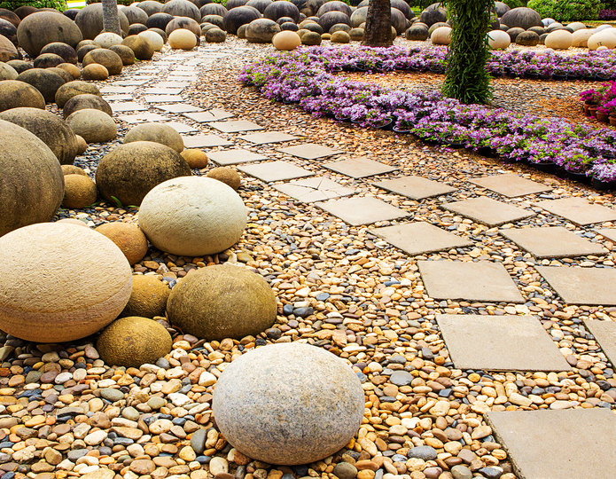 Granite spheres along pathway with tan river rock