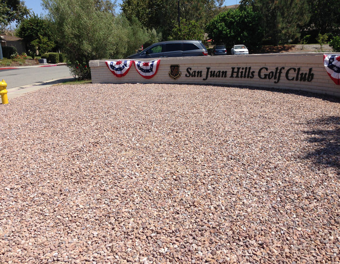 Apache Brown crushed stone rock installed near driveway