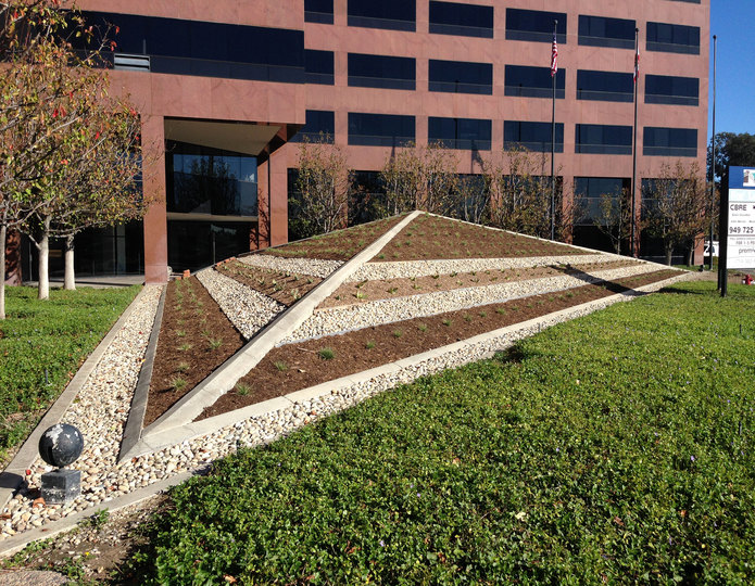 Mexican Beach Pebble buff installed in front of commercial building