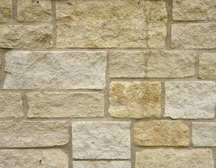 Austin Cream Stone Veneer Natural Ledgestone on rock wall project