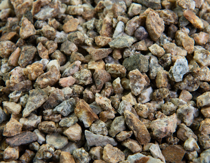 Desert Gold crushed stone rock in bulk at rock yard