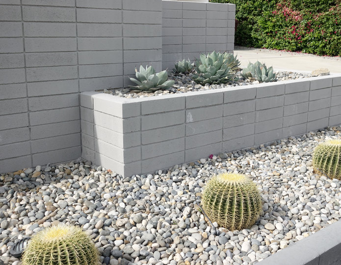 Santa Fe landscape cobblestone pebble installed in front yard with cactus