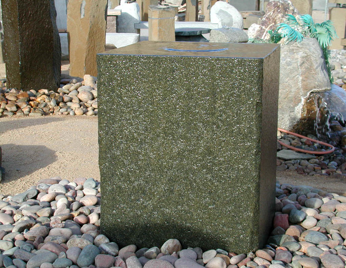 Granite cube stone fountain installed over arizona cobble pebble
