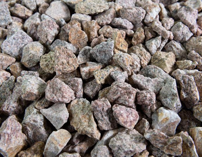 Palomino Coral crushed stone rock in bulk at rock yard