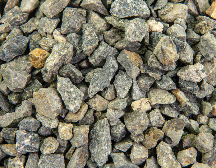 Crushed construction grade stone in bulk at rock yard