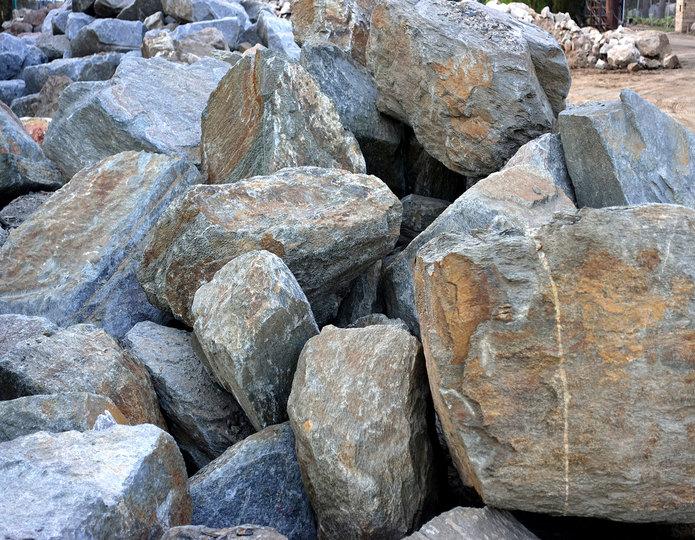 Red Mountain landscape boulders in pile in rock yard