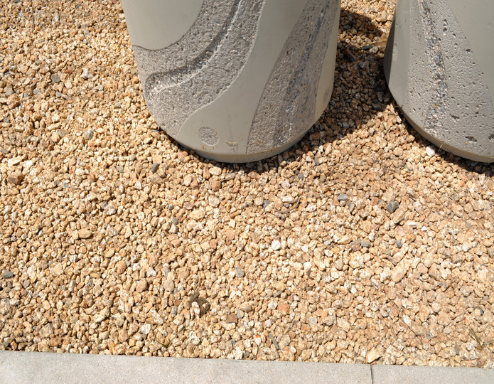 California gold crushed stone in front of building