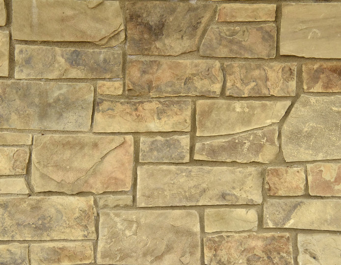 Dappled Leather Stone Veneer Natural Ledgestone on rock wall project