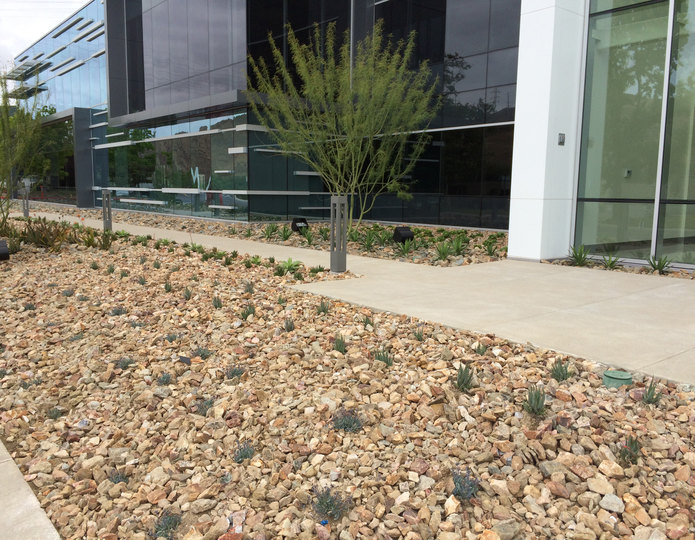 Hickory Creek crushed stone rock installed in front of commercial building 2