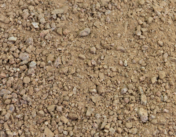 Palomino Coral decomposed granite fines in bulk at rock yard