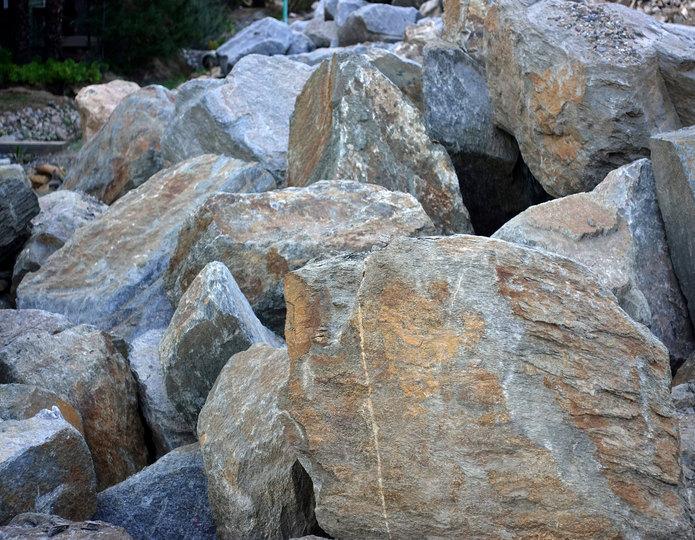 Red mountain landscape boulder pile in rock yard