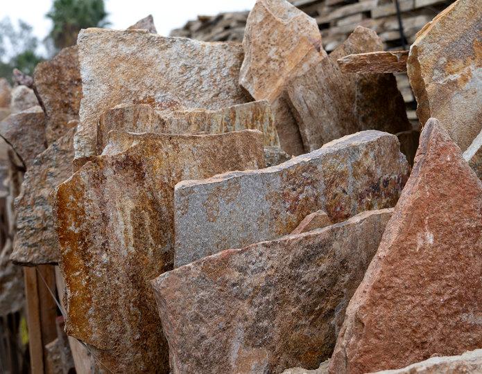 Salmon Red Quartzite natural flagstone patio pavers at rock yard in bulk 5