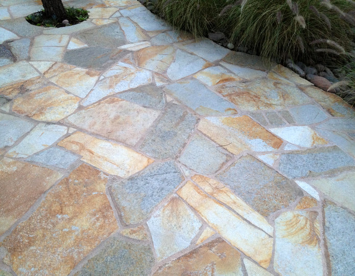 Klondike gold natural flagstone patio pavers installed in front yard patio