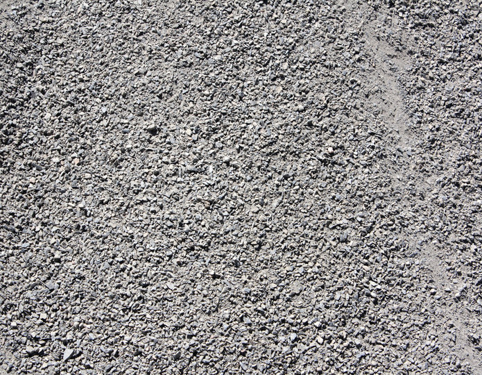 Graphite Gray decomposed granite fines in bulk at rock yard