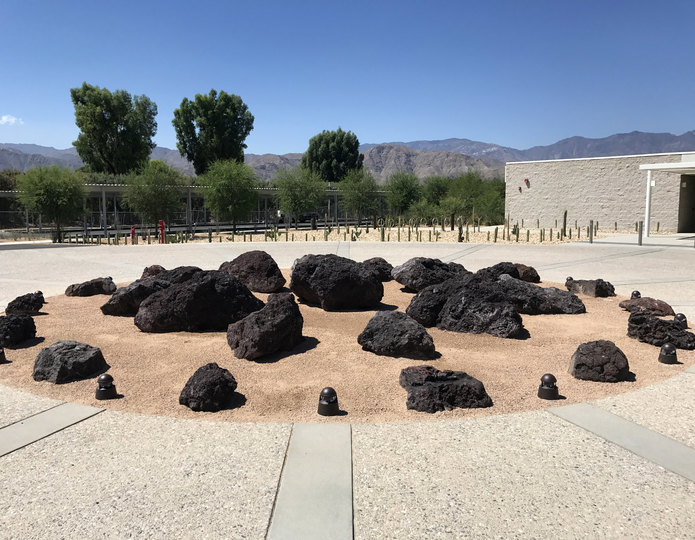 Lava landscape boulders installed on decomposed granite
