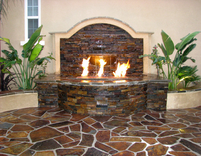 Autumn Flame natural flagstone patio pavers fire pit and waterfall