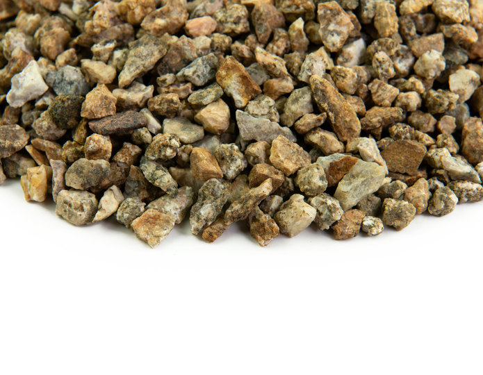 Desert Gold crushed stone rock closeup texture