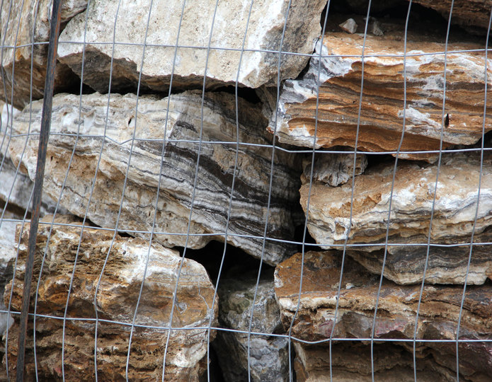 Black Canyon Onyx landscape boulders stacked on pallet in rock yard