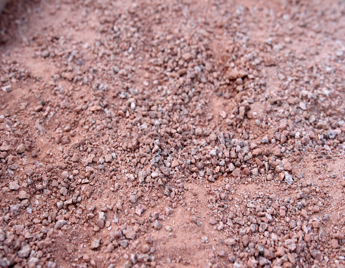 Peach Fusion decomposed granite fines in bulk at rock yard