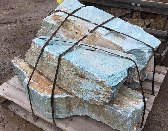Turquoise landscape boulders in rock yard