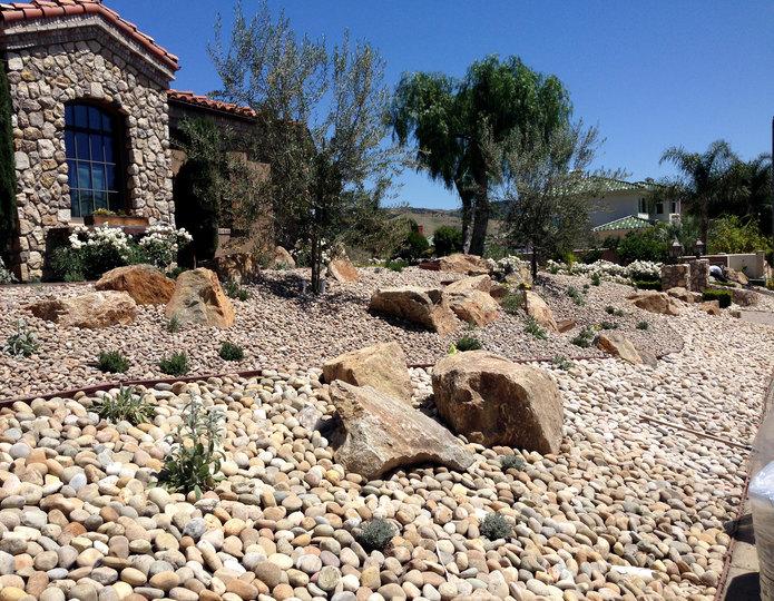 Desert Gold landscape rock in garden with cobblestone pebbles