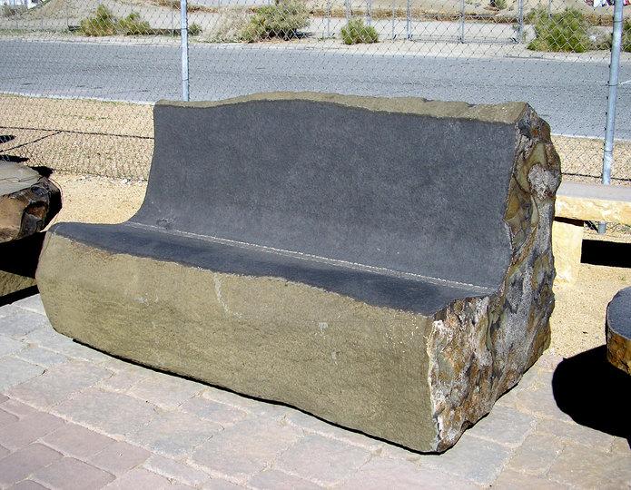 Basalt love seat stone bench installed at rock yard