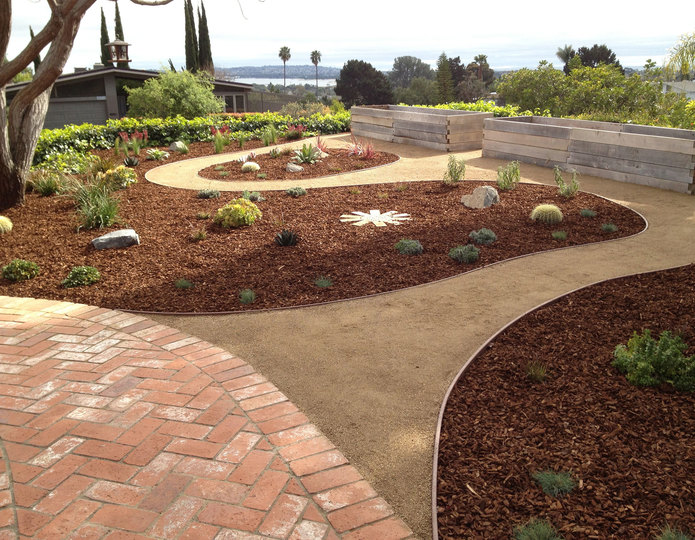 Montana bark nugget mulch on garden lanscape with pathway