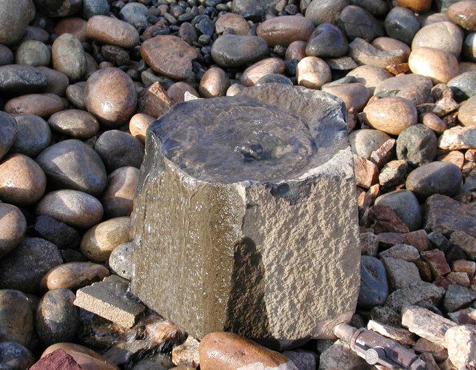 Basalt stone bowl fountain at rock yard 1