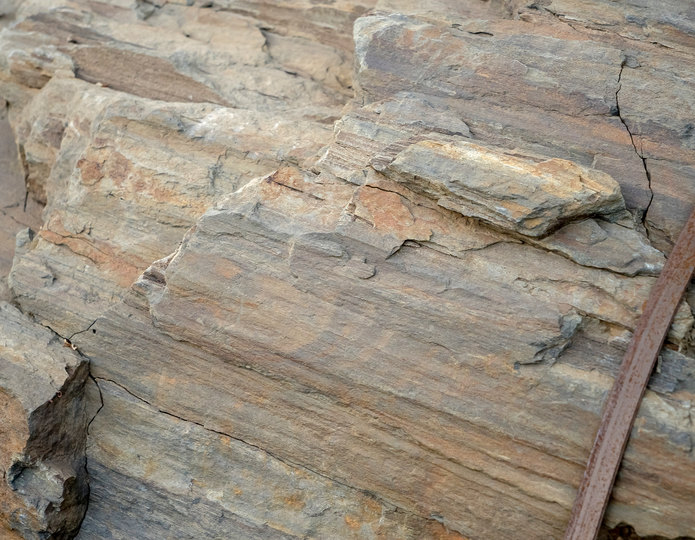 Rainbow Rock landscape boulders in bulk at rock yard closeup texture
