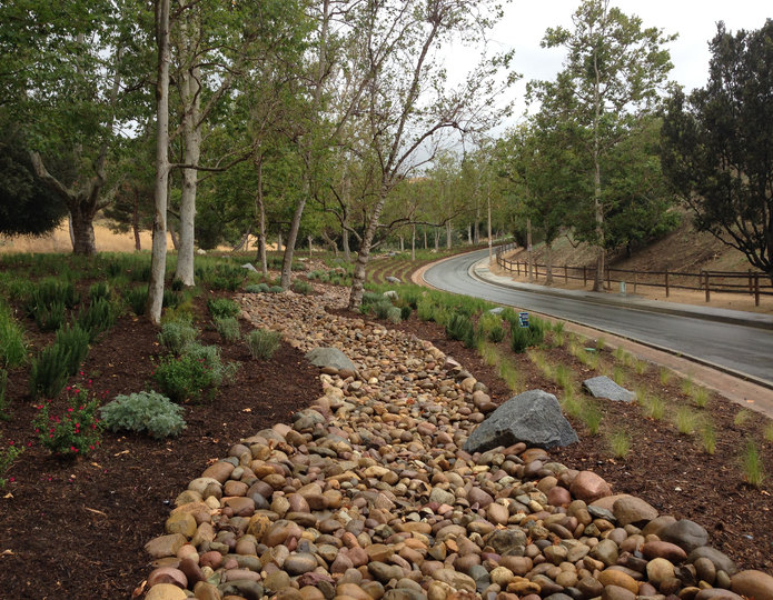 Mission landscape cobblestone pebble installed in dry river bed on side of road