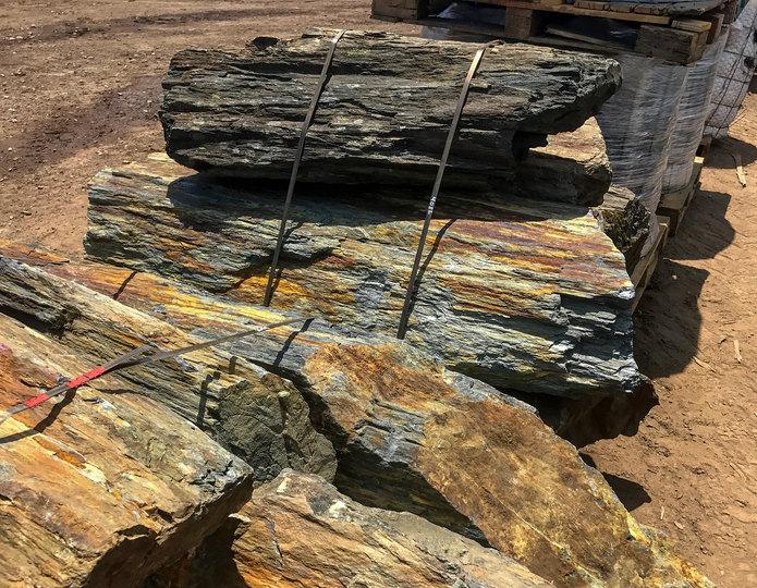 Rainbow Rock landscape boulders in bulk at rock yard