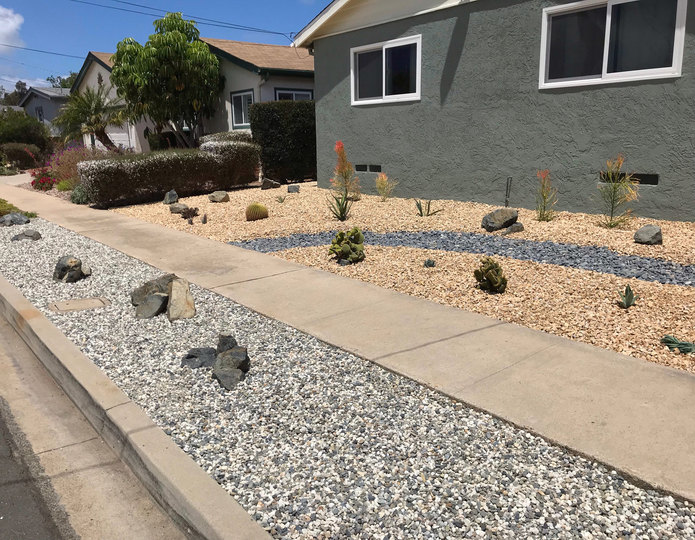 Glacier landscape pebble installed in front yard with crushed rock