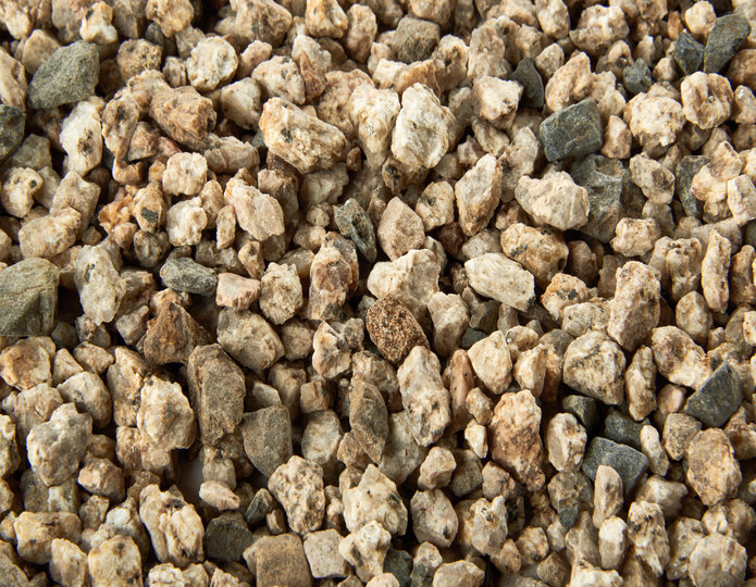 Chamois Beige crushed stone rock in bulk at rock yard