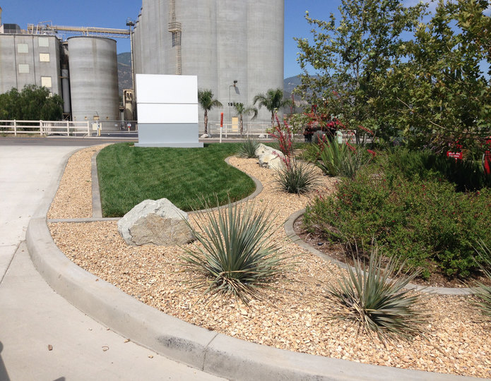 Desert Gold crushed stone rock installed in commercial area with plants and boulders