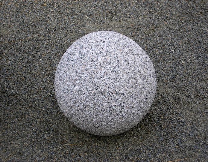 Small undrilled smooth granite sphere at rock yard