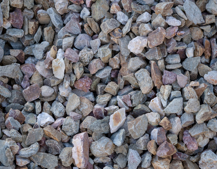 Indian Gold crushed stone rock in bulk at rock yard