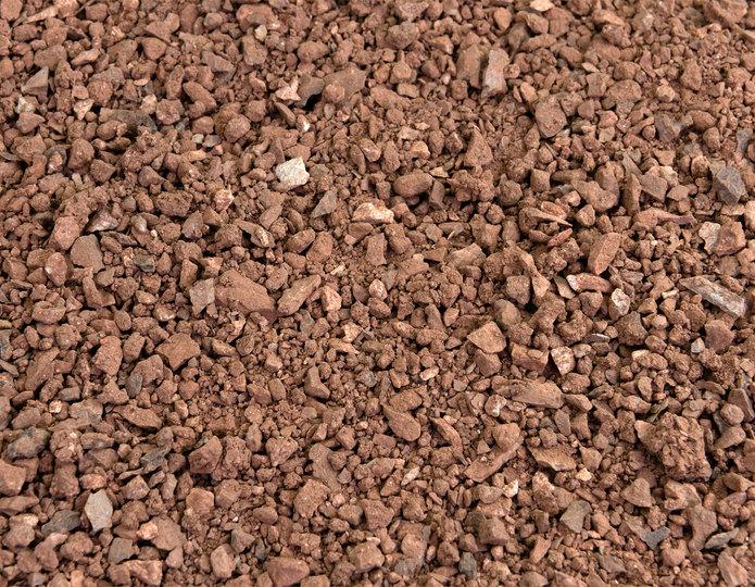 Desert Spice decomposed granite fines in bulk at rock yard