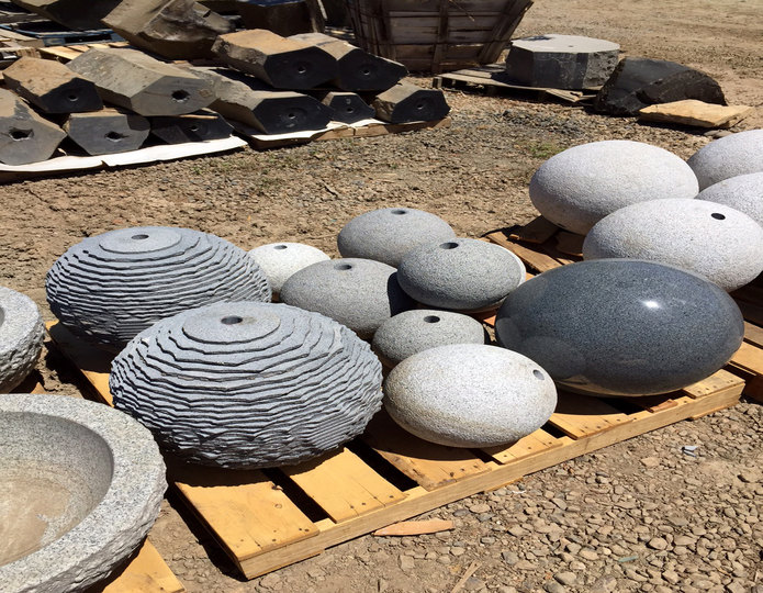 Landscape Granite spheres in bulk at rock yard