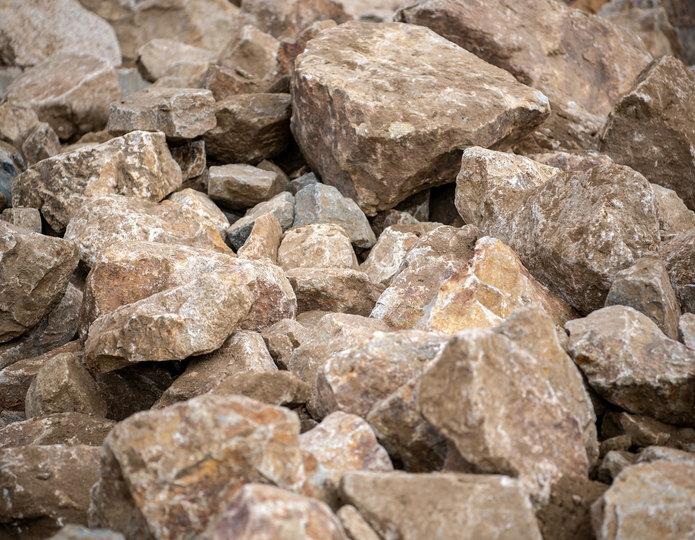 Brown Ale landscape boulder pile in rock yard